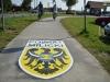 naklejka-chodnikowa-lokalizacja-informacja-02-powiat-milicki-na-drodze-rowerowej